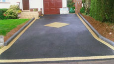Driveway with black tarmac and decoration