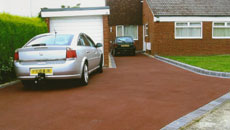 Driveway with red tarmac
